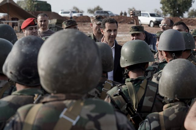 Syrian President Bashar al-Assad (C) meets with Syrian army personnel on front-lines of al-Habit town in Idleb countryside, Syria, on October 22, 2019. File Photo by SANA/EPA-EFE
