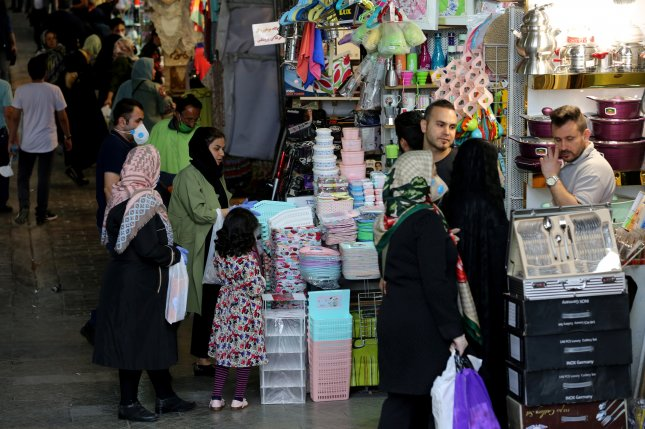 Iranians wearing face masks and protective gloves go shopping at Tehran's grand bazaar on Monday. Photo by Abedin Taherkenareh/EPA-EFE