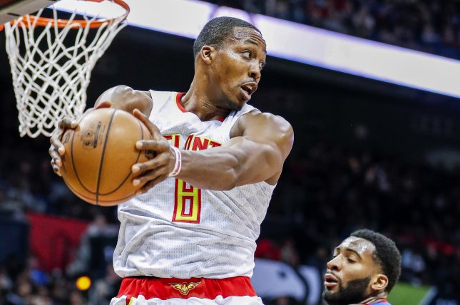 Atlanta Hawks center Dwight Howard (L) takes a rebound away from Detroit Pistons center Andre Drummond (R) during the second half on Dec. 30, 2016 at Philips Arena in Atlanta. EPA/ERIK S. LESSER