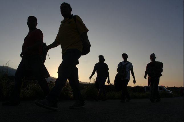 Migrants from Central America begin another day of traveling towards the U.S. border in Huixtla, Chiapas state, Mexico, on Wednesday. Photo by Maria de la Luz Ascencio/EPA-EFE