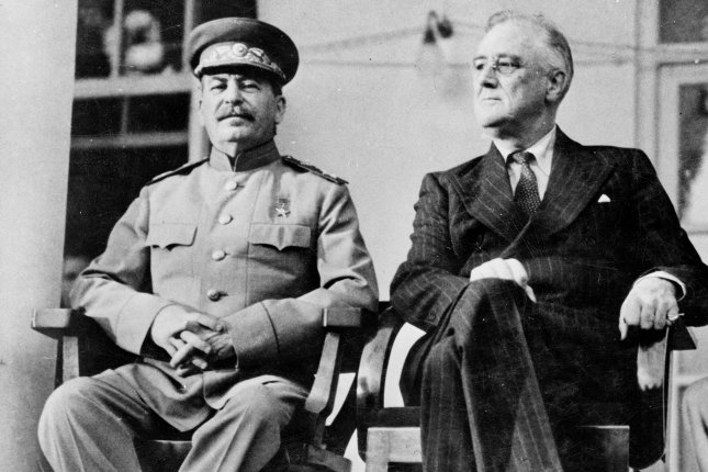 Joseph Stalin and President Franklin D. Roosevelt pictured on the portico of the Russian Embassy during the Tehran Conference in 1943. Photo courtesy the Library of Congress