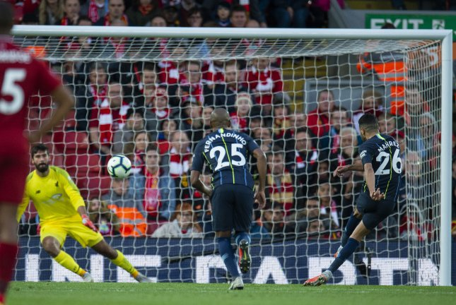 Manchester City's Riyad Mahrez (R) hits his penalty over the bar during an English Premier League soccer match between Liverpool and Manchester City on Sunday at Anfield in Liverpool, Britain. Photo by Peter Powell/EPA-EFE