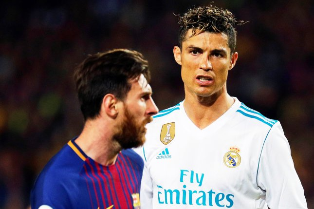 F.C. Barcelona striker Lionel Messi (L) and Real Madrid striker Cristiano Ronaldo (R) react during the Spanish Primera Division soccer match between FC Barcelona and Real Madrid at Camp Nou in Barcelona, Spain. Photo by Alejandro Garcia/EPA-EFE