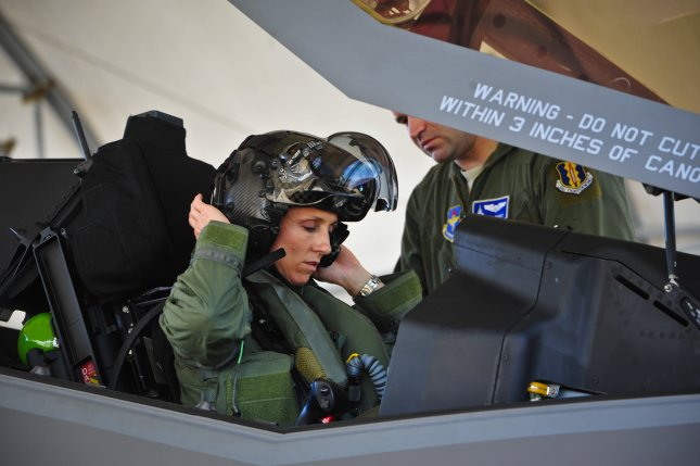 Lt. Col. Christine Mau, 33rd Operations Group deputy commander, puts on her helmet before taking her first flight in the F-35A on Eglin Air Force Base, Fla., May 5, 2015. Mau, who previously flew F-15E Strike Eagles, made history as the first female F-35 pilot in the program. Photo by Staff Sgt. Marleah Robertson/U.S. Air Force/UPI