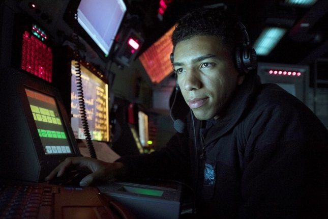 Cryptologic Technician 2nd Class Jonathan Morel, assigned to the Arleigh Burke-class guided-missile destroyer USS Michael Murphy, uses a radar tracking system to track surface contacts. Photo by Mass Communication Specialist 3rd Class Danny Kelley/U.S. Navy