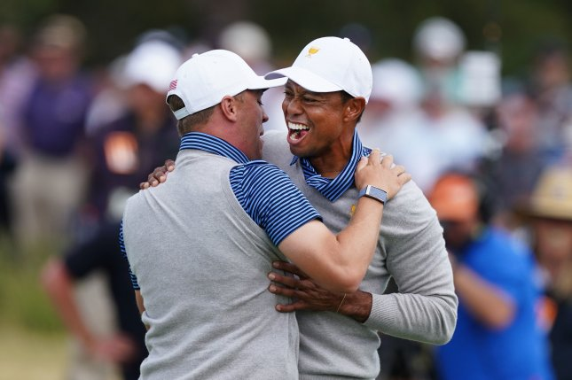 Justin Thomas (L) and Tiger Woods (R) beat Byeong Hun An and Hideki Matsuyama in the fourth match of the second round of the 2019 Presidents Cup to earn a point for the Americans Friday at Royal Melbourne Country Club in Melbourne, Australia. Photo by Scott Barbour/EPA-EFE