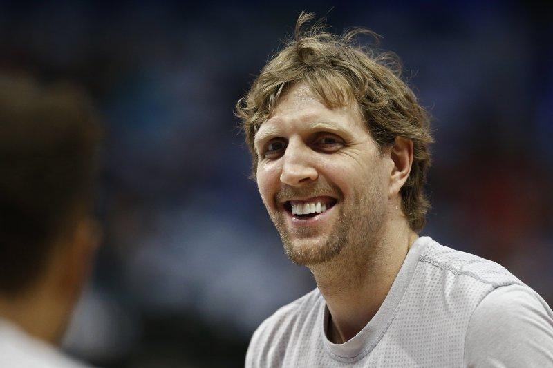 Dallas Mavericks forward Dirk Nowitzki of Germany says he will definitely play next year. Photo by Larry W. Smith/EPA