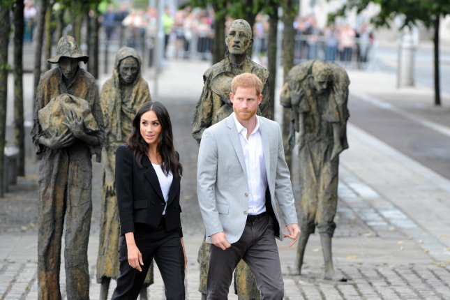 Prince Harry (R) and Meghan Markle visit the Irish Famine Memorial in Dublin, Ireland, on Wednesday. Photo by Aidan Crawley/EPA-EFE