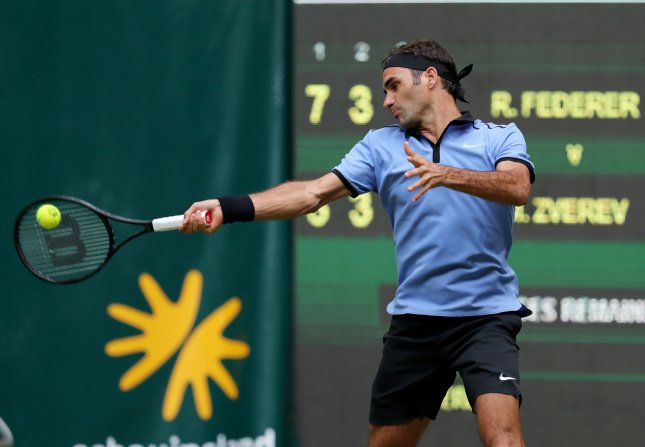 Roger Federer hits a return in his second round match against Mischa Zverev of Germany at the ATP tournament in Halle, Germany. Photo by Tyler Larkin/EPA