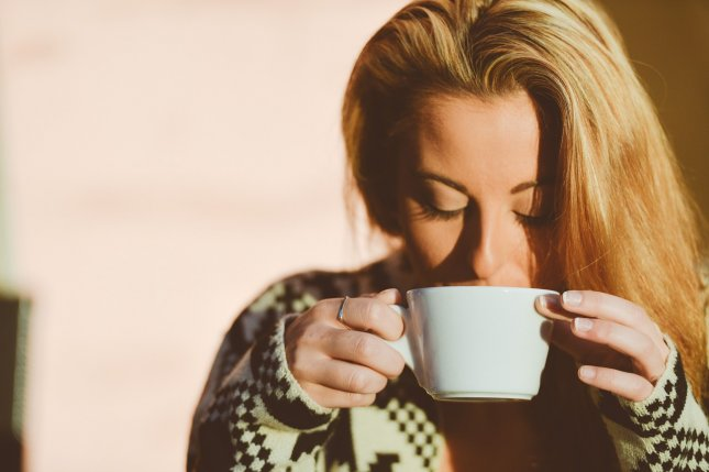 A study found drinking six or more cups of coffee a day can increase your risk of heart disease by up to 22 percent. Photo by stokpic/Pixabay  https://pixabay.com/en/woman-drinking-coffee-person-601568/