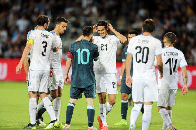 Argentina's Lionel Messi (10) and Edinson Cavani (21) of Uruguay each scored in an international friendly Monday in Tel Aviv, Israel. Photo by Abir Sultan/EPA-EFE