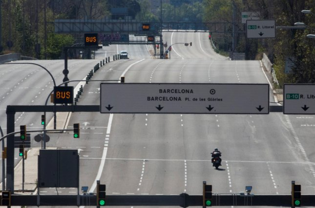 Meridiana Avenue in Barcelona, Spain, is deserted on Sunday as the nation faces the 22nd consecutive day of mandatory home confinement. The nation reported 471 deaths Sunday compared with the peak of 961 Thursday. Photo by Quique Gasrcia/EPA-EFE