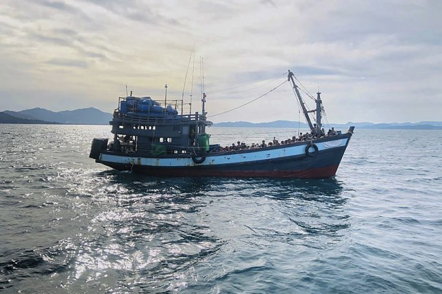 A photo from the Malaysian Maritime Enforcement Agency shows a wooden boat carrying suspected Rohingya migrants in Malaysian territorial waters off the island of Langkawi, Kedah state, Malaysia, on April5.Photo by Maritime Enforcement Agency/EPA-EFE