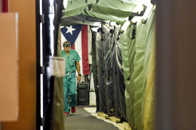 The Puerto Rican flag is displayed at the entrance to an operating room at the 14th Combat Support Hospital in Humacao, Puerto Rico, on October 18. The 14th CSH provided medical care after Hurricane Maria. File Photo by Capt. Christopher Merian/Air Force Space Command