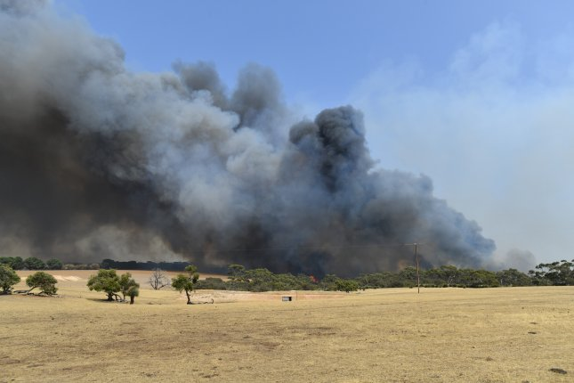 A bushfire sweeps through Stokes Bay in Kangaroo Island, Australia, on Thursday. Photo by David Mariuz/EPA-EFE