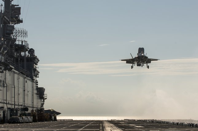 An F-35B test aircraft prepares to land vertically on the deck of the USS Wasp in 2013. Israel uses the F-35 Lightning II and will create its own cyberdefense systems for it. Photo courtesy of Lockheed Martin