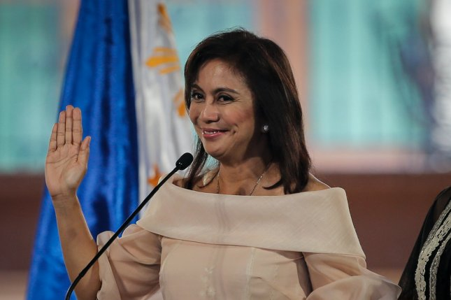 Leni Robredo takes her oath as the vice president of the Philippines in Quezon City, east of Manila, Philippines, on June 30. She announced her resignation as chairwoman of the Housing and Urban Development Coordinating Council on Monday. Robredo, 52, was the wife of Interior Secretary Jesse Robredo, who died in a small plane crash in 2012. Photo by Mark R. Cristino/European Pressphoto Agency.