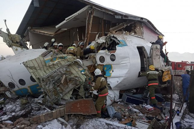 Rescuers work at the site of a plane crash near Almaty airport in Kazakhstan that killed at least 12 Friday. Photo by Committee for Emergency Situations of Kazakhstan/EPA-EFE