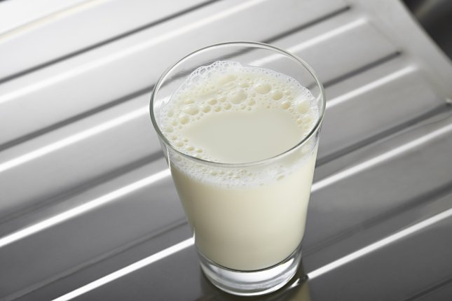 Research suggests switching to lower fat milk could slow biological aging. File Photo by dio5050/Shutterstock.com