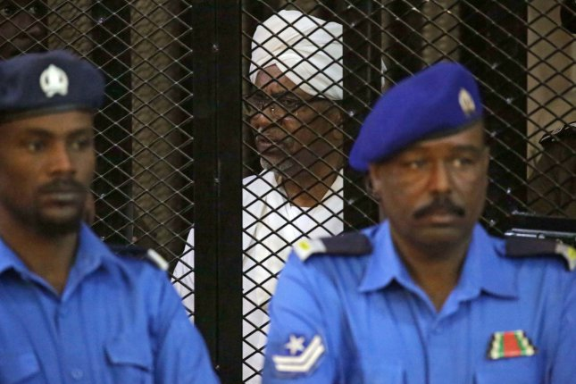 Sudan's ousted president Omar Hassan al-Bashir sits in the defendant's cage during his trial in Khartoum, Sudan, on Saturday. Photo by Morwan Ali/EPA-EFE