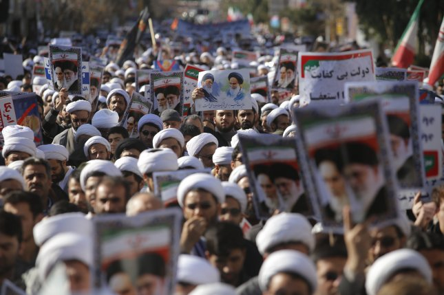 Iranian clerics take part during a state-organized rally against anti-government protests in the country, in the holy city of Qom. Photo by Ali Marizad/EPA