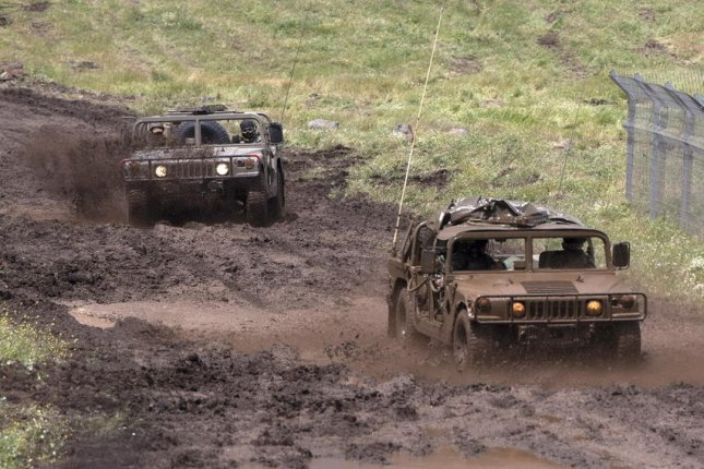 Israeli military vehicles are seen during army training in the Golan Heights near the Israeli-Syrian border on May 6. Reports indicated Israeli warplanes attacked a Syrian weapons factory in Masyaf, killing at least nine. File photo by Atef Safadi/EPA-EFE