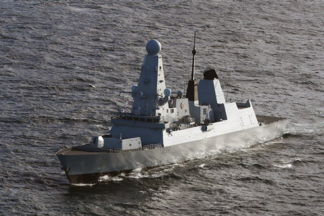 British officials have denied that any warning shots were fired on the HMS Defender, pictured here in 2019, and said it was sailing in international waters.File Photo by Ben Shread/MoD/Crown Copyright/EPA-EFE