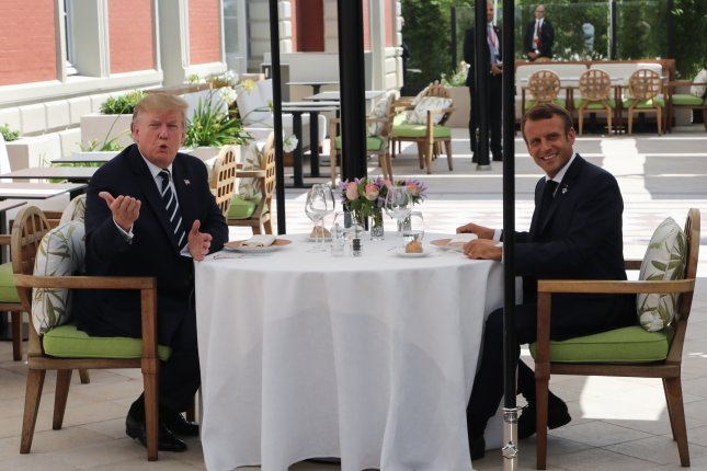 U.S. President Donald Trump (L) has lunch with French President Emmanuel Macron on the first day of the annual G7 Summit at the Hotel du Palais in Biarritz, France on August 24. Pool Photo by Ludovic Marin/EPA-EFE