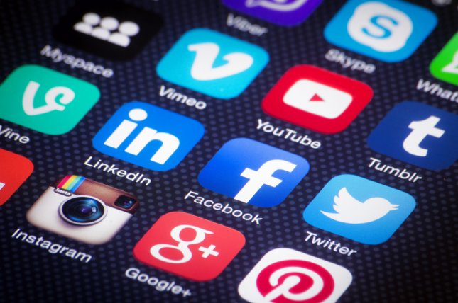 Twitter, whose logo is seen among these social media mobile app icons, has removed thousands of pro-government accounts. File Photo by Twin Design/Shutterstock