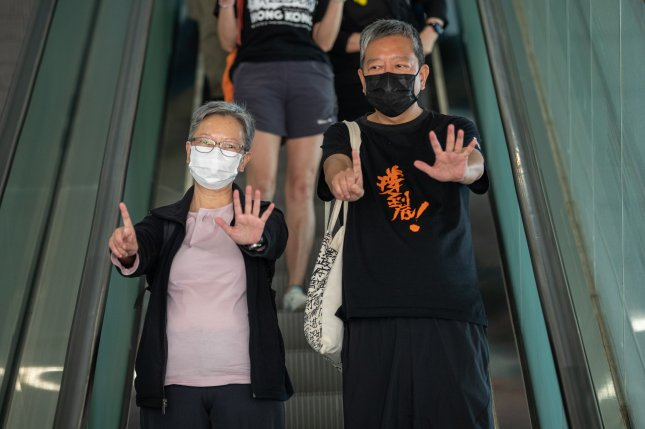 Former lawmakers Lee Cheuk-yan (R) and Cyd Ho leave the West Kowloon court building in Hong Kong, China, on Thursday when they along with five other prominent pro-democracy activists were found guilty of organizing and taking part in an unlawful assembly in August 2019. The judge will hear mitigation pleas on April 16 before passing sentence. Photo by Jerome Favre/EPA-EFE