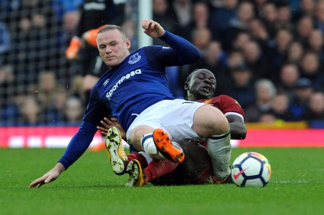 be85c758d4c Everton?s Wayne Rooney (L) and Liverpool's Sadio Mane vie for the ball  during the English Premier League soccer match between Everton and  Liverpool on April ...