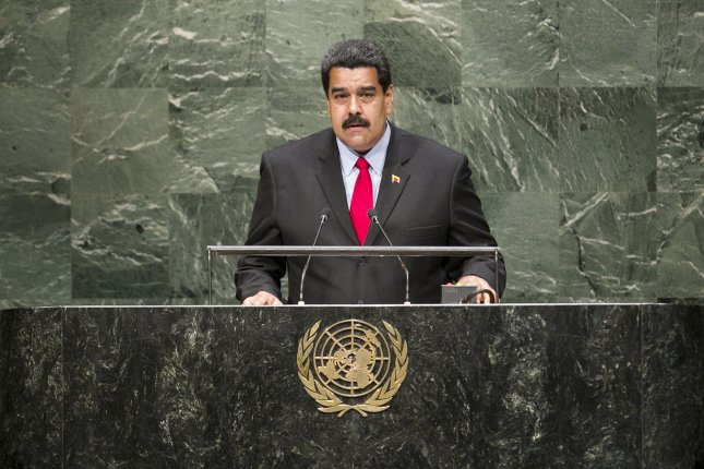 Venezuelan President Nicolas Maduro, seen addressing the 69th Session of the General Assembly of the United Nations, was chased by a mob of protesters on Margarita Island who were wielding pots and screaming at the country's embattled leader that they were hungry late Friday night.