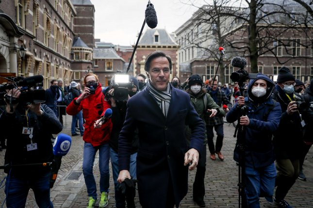 Dutch Prime Minister Mark Rutte walks in the street on Friday after departing The Hague in the Netherlands, where he announced that the Dutch governing coalition has resigned over a scandal related to childcare payments. Photo by Remko De Waal/EPA-EFE