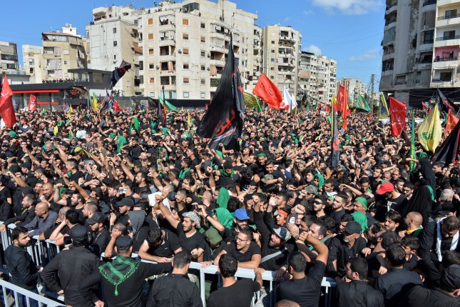 Lebanese Shiite Muslims shout slogans as they listen to a speech by Hezbollah leader Hassan Nasrallah in Beirut, Lebanon, on October 1, 2017. File photo by Wael Hamzeh/EPA-EFE