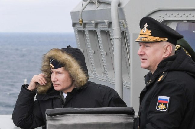 Russian President Vladimir Putin (L) and commander Nikolai Yevmenov are seen during a test of a hypersonic cruise missile on the Black Sea on January 9. File Photo by Alexei Druzhinin/Sputnik/EPA-EFE