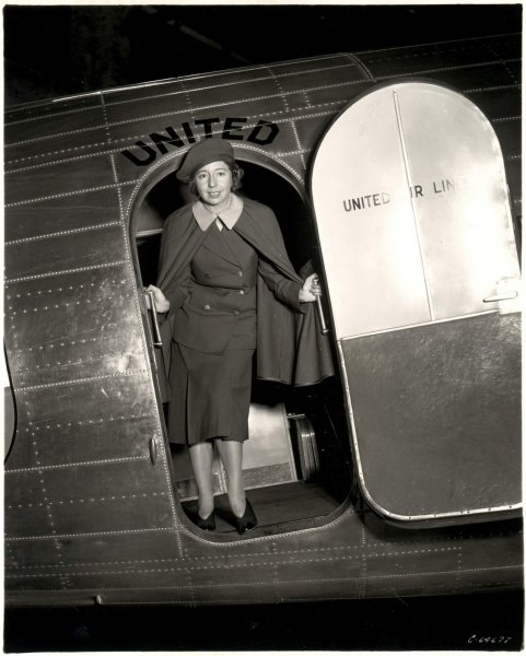 Ellen Church poses standing in doorway of United Airlines Douglas DC-3 wearing an original stewardess uniform, circa 1930. File Photo courtesy of Smithsonian's National Air and Space Museum