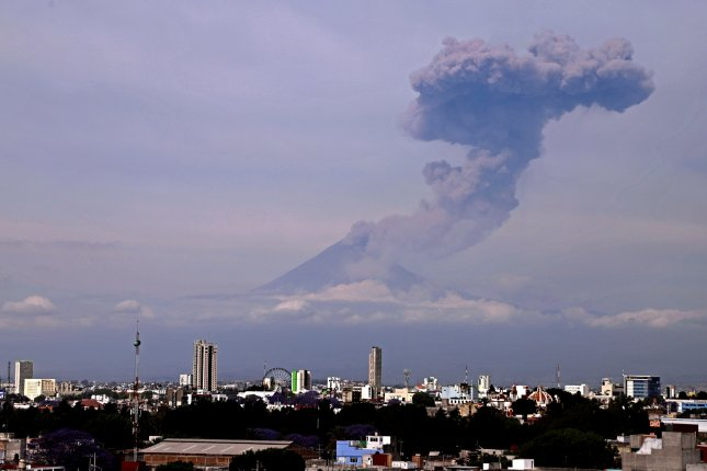 An erupting Popocatepetl volcano is viewed from Puebla, Mexico, on Saturday. Photo by Hilda Rios/EPA-EFE