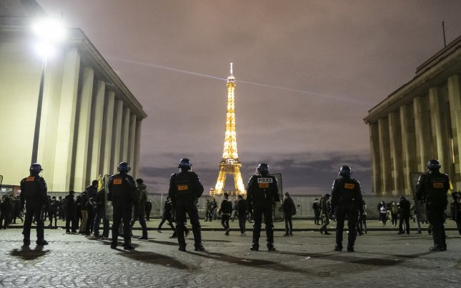 Riot police clear protesters gathered on Place du Trocadero near the Eiffel Tower on November 21after a demonstration against the newly passed global security legislation that aims to ban the distribution of photos in which police officers and gendarmes can be identified. Photo by Ian Langsdon/EPA-EFE
