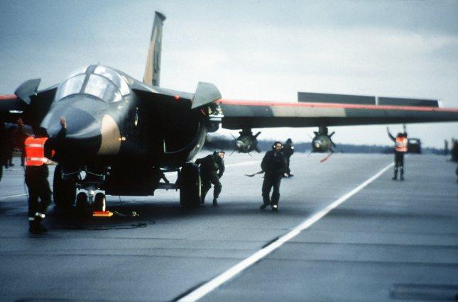 A ground crew is pictured on April 14, 1986, preparing an F-111F aircraft from the 48th Tactical Fighter Wing at RAF Lakenheath for a retaliatory air strike on Libya. The strikes against the regime of Muammar Gaddafi were in response to the bombing of a Berlin discotheque which killed two American serviceman. File Photo by Staff Sgt. Woodward/USAF/UPI