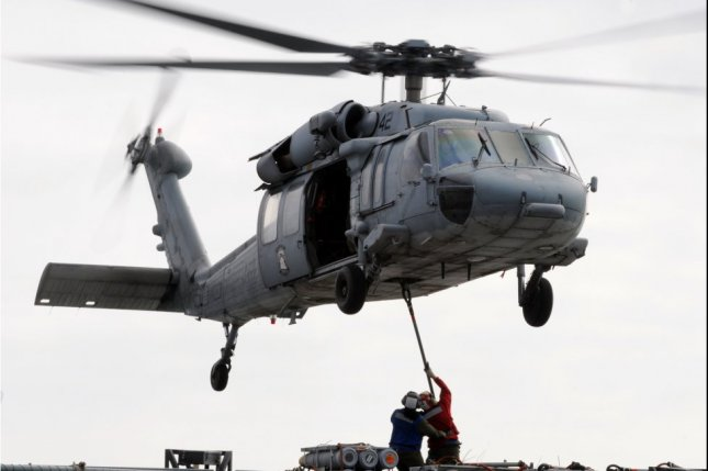 The Navy said the MH-60S chopper, similar to this one, was operating off the USS Abraham Lincoln when it went into the water about 60 nautical miles off San Diego, Calif. File Photo by Specialist 3rd Class Shawn J. Stewart/U.S. Navy/UPI