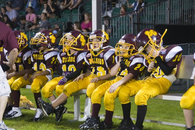 Youth football participation, such as the Florida Pop Warner Super Bowl, pictured, may not affect athletes' ability to recover from concussions later in life, a new study found. File Photo by John Panella/Shutterstock