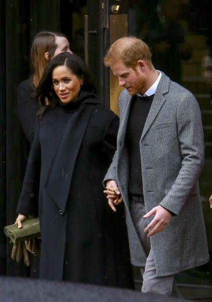 Meghan Markle, duchess of Sussex (L) and Prince Harry, duke of Sussex, greet well-wishers at Bristol Old Vic theater in Bristol, England, on Friday. Photo by Geoff Caddick/EPA-EFE