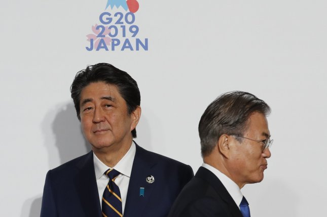 Japanese Prime Minister Shinzo Abe (L) and South Korean President Moon Jae-in (R) have not resolved disputes over wartime compensation and trade that began in 2019. File Photo by Kim Kyung-hoon/EPA-EFE/POOL