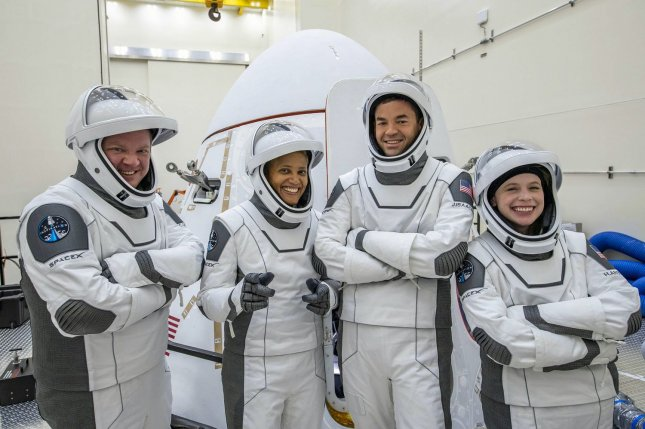 Inspiration4 crew members try out their flight suits during training: mission specialist Chris Sembroski (L-R), pilot Sian Proctor, medical officer Hayley Arceneaux and commander Jared Isaacman. Photo courtesy of Inspiration4