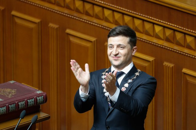 President Volodymyr Zelenskiy reacts during his inauguration in Ukrainian parliament in Kiev, Ukraine. photo by Sergey Dolzhenko/EPA-EFE