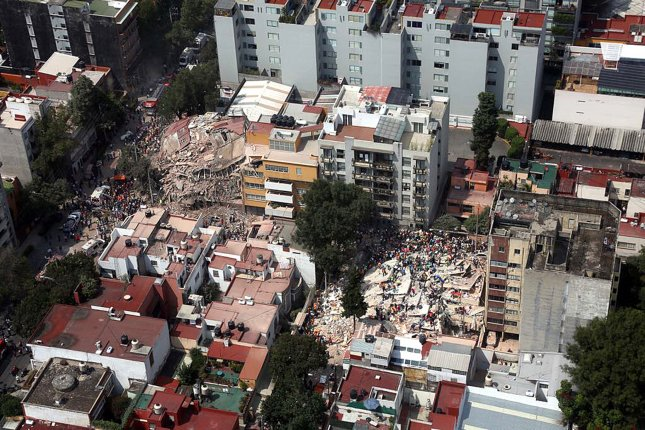 Hundreds of people, including injured and rescuers, amidst collapsed buildings following a 7.1 magnitude earthquake in Mexico City on Sept. 19. Photo by EPA-EFE