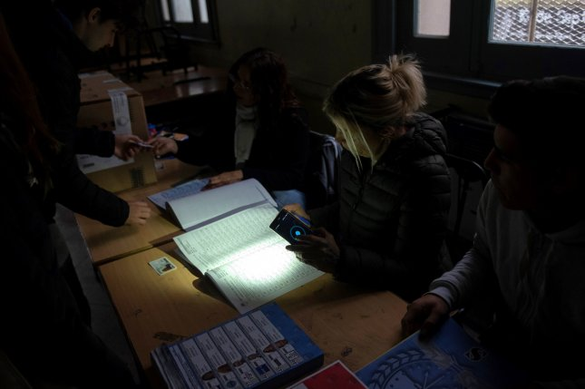 In the dark, people vote in gubernatorial elections in Rosario, Argentina, on Sunday after a national power outage. Photo by Franco Trovato Fuoco/EPA-EFE