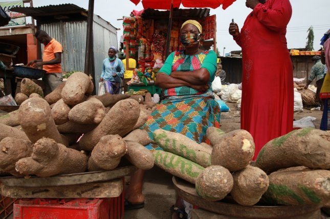 A woman selling tuber waits for customers at a market in Nigeria's commercial capital Lagos, on Monday. Experts say African countries would benefit from digitized financial services during the pandemic. Photo by Akintunde Akinleye/EPA-EFE