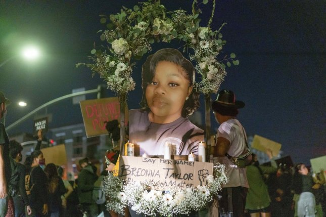Protesters march with an effigy of Breonna Taylor during a demonstration in Los Angeles after the results of a grand jury probe into her death in Louisville, Ky., were announced Wednesday. Photo by Kyle Grillot/EPA-EFE