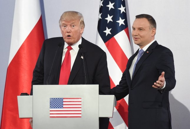 President of Poland Andrzej Duda (R) and U.S. President Donald Trump (L) speak following a press conference at the Royal Castle in Warsaw, Poland, on Thursday. Photo by Radek Pietruszka/EPA